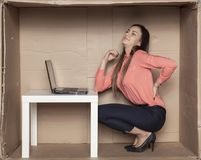 Business woman struggles with backache, uncomfortable office stock photo