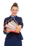 Business woman struggling to carry big files Royalty Free Stock Images