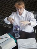 Business Woman/Student. A business woman, or a student, is consulting her crystal ball Stock Image