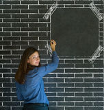 Business woman, student or teacher on brick wall notice board. Business woman, student or teacher with brick wall notice board looking at you checklist on Stock Image