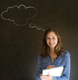 Woman with thought thinking chalk cloud writing on note pad Stock Images
