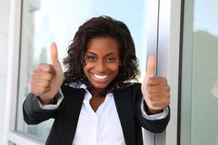 Business Woman Success. A pretty african american business woman with thumbs up Royalty Free Stock Photos
