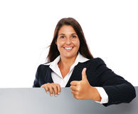 Business woman success. Business woman showing thumbs up with a blank grey sign.    Isolated on a white background Stock Photography
