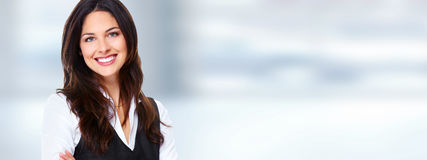 Business woman. Successful business woman over abstract office background Royalty Free Stock Photo