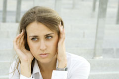 Business woman suffering from headache Stock Image