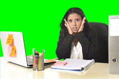 Business woman suffering stress working at office isolated green chroma key background. Young beautiful latin business woman suffering stress working at office Royalty Free Stock Image
