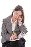 Business woman in a suit. Woman talking on the phone and wrote in the weekly Stock Image