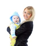 Business woman in suit carrying baby Stock Photography