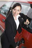 Business Woman In Suit Refueling Her Red Car Royalty Free Stock Photography