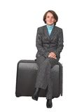 Business woman on suitcase 2 Royalty Free Stock Photo