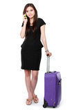 Business woman with a suitcase calling Stock Image