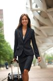 Business woman with suitcase in the city Stock Photos