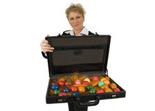 Business Woman with a briefcase full of eggs. Business woman with a briefcase full of easter-eggs Stock Photos