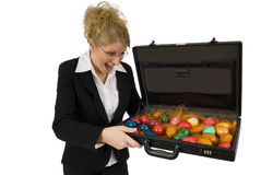 Business Woman with a suitcase full of eggs. Business woman with a suitcase full of easter-eggs Royalty Free Stock Photo
