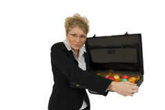 Business Woman with a briefcase full of eggs. Business woman with a suitcase full of easter-eggs Stock Image