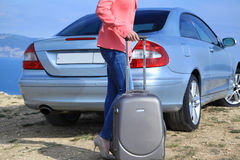 Business woman with suitcase near the car Stock Image