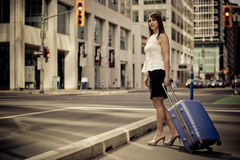 Business woman with a suitecase downtown Royalty Free Stock Photos