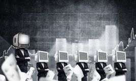 Modern technologies against old one. Business woman in suits with monitors instead of their heads keeping arms crossed while standing in a row and one at the Stock Photo