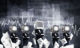Modern technologies against old one. Business woman in suits with old TV instead of their heads keeping arms crossed while standing in a row and one at the head Royalty Free Stock Photo