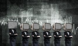 Modern technologies against old one. Business woman in suits with old TV instead of their heads keeping arms crossed while standing in a row and one at the head Stock Photography