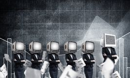 Modern technologies against old one. Business woman in suits with old TV instead of their heads keeping arms crossed while standing in a row and one at the head Royalty Free Stock Image