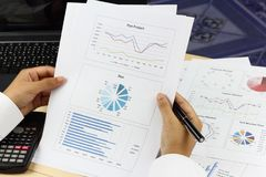 Business woman Summary report and analyzing market plan. Pen and calculator on paperwork Stock Photography