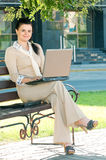 Business woman in summer park royalty free stock photo