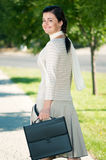 Business woman in summer park stock photography