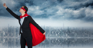 Business woman superhero taking off against skyline Royalty Free Stock Photography