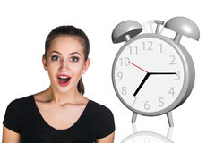 Business woman surprised big gray alarm clock Royalty Free Stock Photography