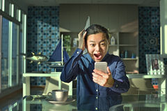 Business woman surprised on mobile phone Royalty Free Stock Images