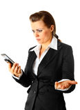 Business woman surprisedly looking at mobile phone Stock Photos