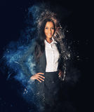 Business woman surrounded by sparkles and smoke Stock Image