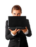 Business woman suspicious looks out from laptop Royalty Free Stock Photos