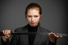 Business woman with a sword Stock Photos