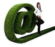 Business woman with an 'at' symbol Royalty Free Stock Images