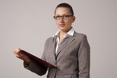 Business woman with tablet. Business woman look at camera and looks strong Royalty Free Stock Photos