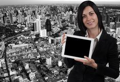 Business woman and a tablet Royalty Free Stock Photos