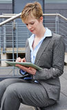 Business woman with tablet computer in city Stock Photo