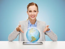 Business woman with tablet pc and globe hologram Stock Image