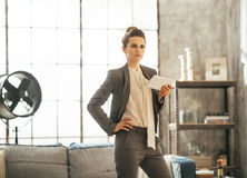 Business woman with tablet pc in loft apartment Stock Photography