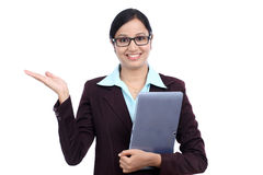 Business woman with tablet PC and showing her palm up Royalty Free Stock Photo