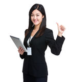 Business woman with tablet and thumb up Stock Photography