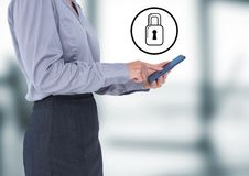 Business woman with tablet and white lock graphic against blurry office Royalty Free Stock Image