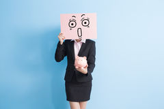 Business woman take billboard. Businesswoman take surprised billboard and show piggy bank to you isolated with blue background Stock Photo