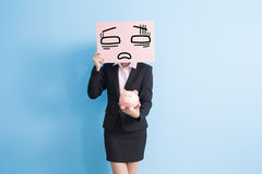 Business woman take billboard. Businesswoman take tired billboard and show piggy bank to you isolated with blue background Stock Photo