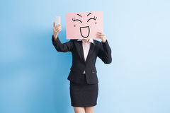 Business woman take billboard. Business woman take happy billboard and selfie, isolated blue background stock photos