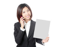 Business woman take blank paper and speaking phone Royalty Free Stock Images