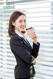 Business woman enjoy coffee. Business woman take a break and enjoy good coffee in the office stock image