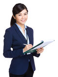 Business woman take note on clipboard Royalty Free Stock Photography